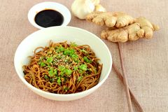 Soba noodle soy sauce. Soba noodle with ginger garlic soy sauce garnish with parsley and sesame seeds Stock Image