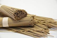 Soba noodle. Stacked bundles of Japanese buckwheat soba noodle; on white background royalty free stock photos