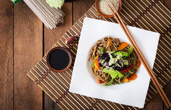 Soba noodles with beef, carrots, onions. Royalty Free Stock Image