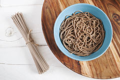 Soba noodles in a bowl with uncooked soba. Top view Royalty Free Stock Image