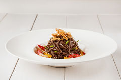 Soba noodles of buckwheat Noodles of buckwheat yellow pepper, tomato and herbs. Pan-Asian cuisine. Place for text. Square photo size. Copy space Stock Images