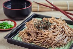 Soba noodles with dried seaweed on plate, Japanese food Royalty Free Stock Photo