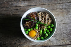 Soba noodles with green peas, shitake mushroom and quail egg Stock Photography