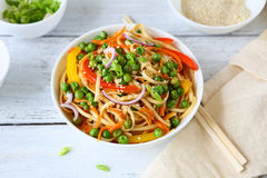 Soba noodles. With peas in bowl royalty free stock photo