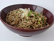 Soba noodles salad. With soy sauce dressing,scallions and sesame seeds Stock Image