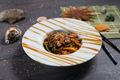 Soba noodles with shrimp on a dark wooden background Stock Photos