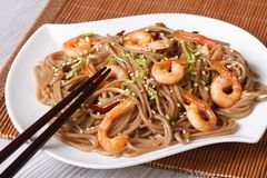 Soba noodles with shrimp and sesame seeds horizontal Stock Images