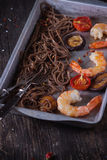 Soba noodles and shrimps Stock Photos