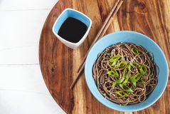 Soba noodles with soy sauce and chopsticks on the side. Top view. Selective focus Stock Photos