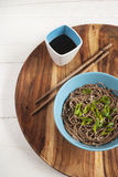 Soba noodles with soy sauce on the side. Top view. Selective focus Royalty Free Stock Photo