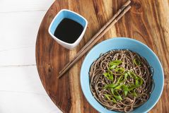 Soba noodles with soy sauce on the side. Top view. Selective focus Stock Image