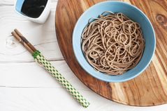 Soba noodles with soy sauce on the side. Top view Stock Images