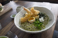 Soba noodles. With tempura prawns, nori, eggs royalty free stock images