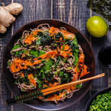 Soba noodles with vegetables and seaweed. Royalty Free Stock Images