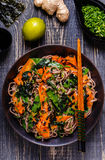 Soba noodles with vegetables and seaweed. Royalty Free Stock Image