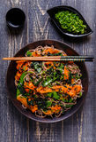 Soba noodles with vegetables and seaweed. Royalty Free Stock Photo