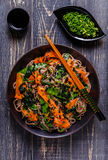 Soba noodles with vegetables and seaweed. Royalty Free Stock Photos