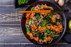 Soba noodles with vegetables and seaweed. Royalty Free Stock Photography