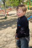 Sobbing boy. Sobbing sweet little boy on a playground Royalty Free Stock Images