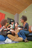 Sobbing Hippie with Friends. Group of friends sitting on shag rug with pouting friend Stock Photos