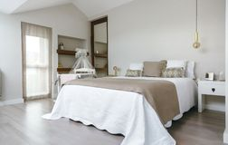 Bedroom with double bed and cot Stock Photo