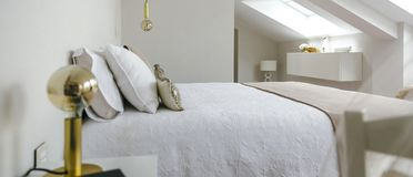 Bedroom with queen size bed. Sober and elegant bedroom with queen size bed royalty free stock images