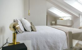 Bedroom with queen size bed. Sober and elegant bedroom with queen size bed royalty free stock photos