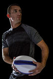 Sober rugby player holding ball Stock Image