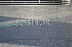Sobibor meddelandecloseup på stenväggen, Royaltyfria Bilder