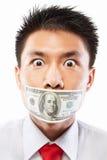 Soborne el concepto, boca sellada con la cuenta de dólar Imagen de archivo