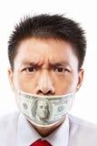 Soborne el concepto, boca sellada con la cuenta de dólar Foto de archivo libre de regalías