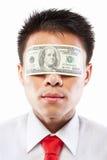 Soborne el concepto, ojos sellados con la cuenta de dólar Foto de archivo libre de regalías