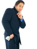 Soborno del hombre de negocios joven con el dinero Imagenes de archivo