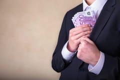 Soborno y corrupción con los billetes de banco euro imágenes de archivo libres de regalías