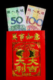 Sobre chino Lai Si del Año Nuevo con el dinero Fotografía de archivo