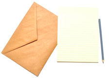 Sobre con la libreta y el lápiz Imágenes de archivo libres de regalías