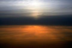 Sobre las nubes, puesta del sol Fotografía de archivo libre de regalías