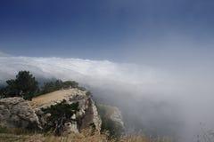 Sobre nuvens Imagem de Stock Royalty Free