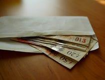 Sobre por completo de libras británicas fotos de archivo libres de regalías
