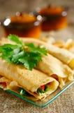 Sobremesa com as panquecas roladas Imagem de Stock Royalty Free
