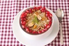 Sobremesa de Ashura em um fundo vermelho-branco Imagens de Stock Royalty Free