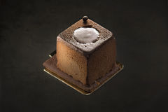 Sobremesa escura do chocolate em um fundo preto Fotografia de Stock Royalty Free