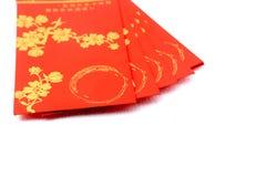 Sobres rojos para la celebración china del Año Nuevo sobre el fondo blanco Imagen de archivo libre de regalías