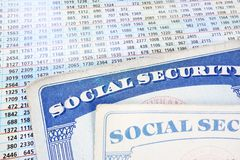 Soc Security cards and numbers. Social Security cards and a sheet of budget numbers stock photography