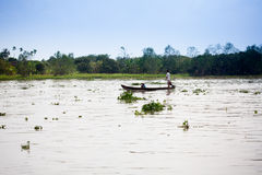 SOC TRANG, VIETNAM - JAN 28 2014: Unidentified man rowing boats Royalty Free Stock Photos