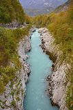 Soca River Near Kobarid. The Soca River called Izonso in Italian as it flows near Kobarid in north west Slovenia in the autumn Royalty Free Stock Photography