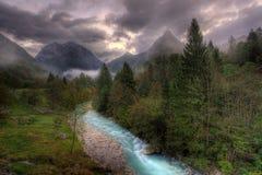 The Soca river, Slovenia. The river through the Alpine valley with dramatic sky. The Soca river, Slovenia Stock Photography
