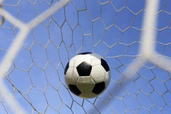Socce in the goal net Stock Image