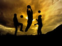 Soccer. Players silhouette with warm sunset as background stock image