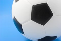 Soccer. Ball on blue background Royalty Free Stock Photos